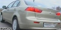 Mitsubishi Lancer X сзади бежевый