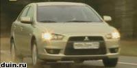 Mitsubishi Lancer X бежевый спереди в движении