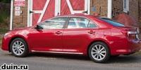 Toyota Camry 2012 года красный сбоку